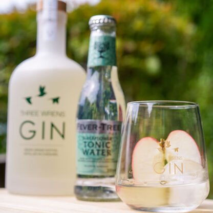 gin glass sliced apple tonic water-bison grass serving suggestion