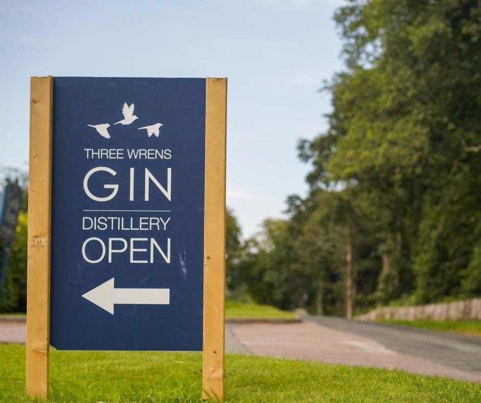 three wrens gin distillery road sign